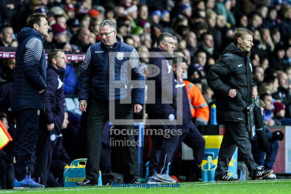 Aston Villa manager Paul Lambert (2nd left) looks relieved after the Barclays Premier League match at Villa Park, Birmingham<br /> Picture by Andy Kearns/Focus Images Ltd 0781 864 4264<br /> 07/12/2014