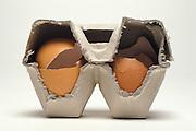 two broken eggs in an egg carton