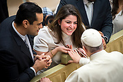 Pope Francis meets with newly married couples at the end of his weekly general audience at the Paul VI hall on January 10, 2018 at the Vatican.