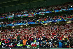 LILLE, FRANCE - Friday, July 1, 2016: Wales supporters celebrate after a 3-1 victory over Belgium and reaching the Semi-Final during the UEFA Euro 2016 Championship Quarter-Final match at the Stade Pierre Mauroy. (Pic by David Rawcliffe/Propaganda)