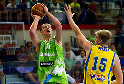 Alen Omic of Slovenia vs Sebastian Norman of Sweden during basketball match between National teams of Sweden and Slovenia in First Round of U20 Men European Championship Slovenia 2012, on July 13, 2012 in Domzale, Slovenia. (Photo by Vid Ponikvar / Sportida.com)