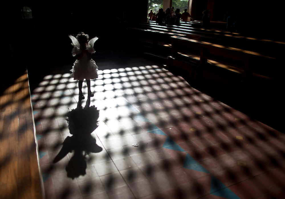 "A girl, disguised as angel is seen during ""Blood of Christ"" celebrations at the Metropolitan Cathedral in Managua, Nicaragua, Friday, March 30, 2012. The celebration of ""Blood of Christ"" marks the start of the Holy Week in Nicaragua."