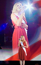 December 29, 2006 - Uncasville, CT - Miss Maine Erin Good sings the National Anthem before the inaugural IFL team championships at the Mohegan Sun Arena in Uncasville, CT.  In the team finals the Silverbacks defeated the Wolfpack 4-1 to capture the IFL team title.