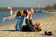 Mother and son at the beach on an unusually warm January day at Theodore Roosevelt Memorial Park in Oyster Bay, N.Y.
