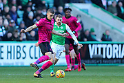 Jozo Simunovic (#5) of Celtic takes on Martin Boyle (#17) of Hibernian during the Ladbrokes Scottish Premiership match between Hibernian and Celtic at Easter Road, Edinburgh, Scotland on 10 December 2017. Photo by Craig Doyle.