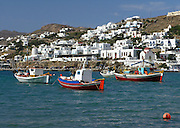 fishing boats in Aegean Sea, town of white buildings on hillside