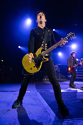 © Licensed to London News Pictures. 21/08/2013. London, UK.   Green Day performing an intimate pre-Reading & Leeds Festivals warmup gig at Brixton Academy, in advance of their headline performances at the festivals this coming weekend.  In this pic - Billie Joe Armstrong (left) and  Jason White (right).  Green Day is an American punk rock band formed in 1987. The band consists of lead vocalist and guitarist Billie Joe Armstrong, bassist and backing vocalist Mike Dirnt, drummer Tré Cool and guitarist and backing vocalist Jason White.  Photo credit : Richard Isaac/LNP