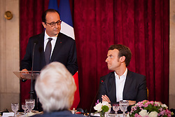 President Francois Hollande speaks prior to a dinner with Ministerof Economy Emmanuel Macron and a group of international CEOs for the Strategic Council for Attractiveness at the Elysee Palace in Paris, France on October 19, 2014. Photo by Audrey Poree/ABACAPRESS.COM
