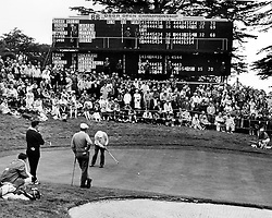 Ben Hogan putting, watched by his playing partners Frank Beard and Ken Venturi at the Olympic Club in San Francisco, Ca during the 1966 U.S.Open..(1966 copyright by Ron Riesterer)