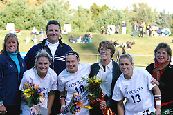 The University of Virginia honored it's three graduating seniors prior to the start of their final regular season home  game against North Carolina State University.  Pictured from left to right with their families: Kelly Hammond (#21), Sarah Huffman (#10), and Noelle Keselica (#13).