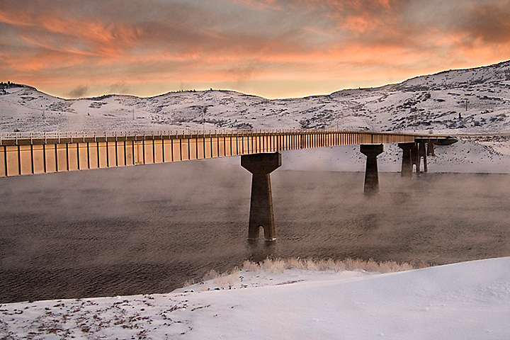 A bridge spanning the Gunnison River in Colorado at twilight.