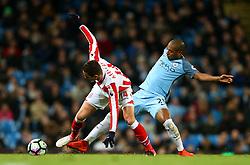 Fernandinho of Manchester City tackles Ibrahim Afellay of Stoke City - Mandatory by-line: Matt McNulty/JMP - 08/03/2017 - FOOTBALL - Etihad Stadium - Manchester, England - Manchester City v Stoke City - Premier League