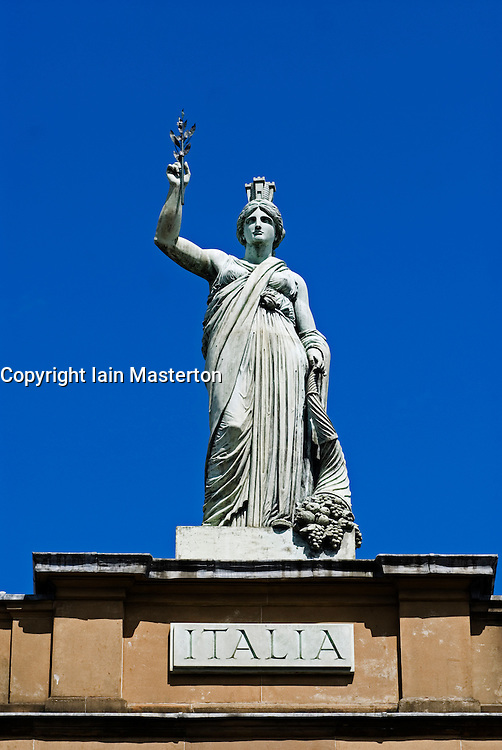Ornate statue on roof of The Italian Centre historic building in Merchant City district of Glasgow Scotland