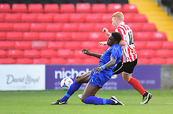 Lincoln City's Reece Robinson-Jones vies for possession with Leicester City's Calvin Bassey<br /> <br /> Lincoln City under 18s Vs Leicester City under 18s at Sincil Bank, Lincoln.<br /> <br /> Picture: Chris Vaughan/Chris Vaughan Photography<br /> <br /> Date: July 28, 2016