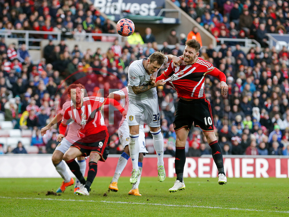 Connor Wickham of Sunderland heads a shot as Liam Cooper of Leeds United challenges - Photo mandatory by-line: Rogan Thomson/JMP - 07966 386802 - 04/01/2015 - SPORT - FOOTBALL - Sunderland, England - Stadium of Light - Sunderland v Leeds United - FA Cup Third Round Proper.
