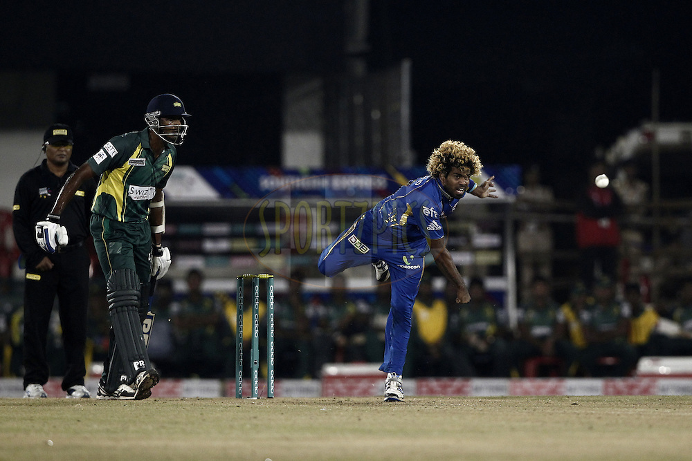 Lasith Malinga of the Mumbai Indians  during the qualifier 4 match of the Oppo Champions League Twenty20 between the Mumbai Indians and the Southern Express held at the Chhattisgarh International Cricket Stadium, Raipur, India on the 14th September 2014<br /> <br /> Photo by:  Deepak Malik / Sportzpics/ CLT20<br /> <br /> <br /> Image use is subject to the terms and conditions as laid out by the BCCI/ CLT20.  The terms and conditions can be downloaded here:<br /> <br /> http://sportzpics.photoshelter.com/gallery/CLT20-Image-Terms-and-Conditions-2014/G0000IfNJn535VPU/C0000QhhKadWcjYs