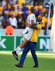 Cape Town--180401  Mamelodi Sundowns fan celebrates with Tiyani Mabunda after his team win in  Nedbank Cup quarter final game at the Cape Town Stadium.Sundowns won the game 2-1 and will play maritzburg in the Semi-final  .Photographer;Phando Jikelo/African News Agency/ANA