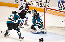 April 16, 2010; San Jose, CA, USA; Colorado Avalanche right wing Brandon Yip (59) scores a goal past San Jose Sharks goaltender Evgeni Nabokov (20) during the second period of game two in the first round of the 2010 Stanley Cup Playoffs at HP Pavilion.  The Sharks defeated the Avalanche 6-5 in overtime. Mandatory Credit: Jason O. Watson / US PRESSWIRE