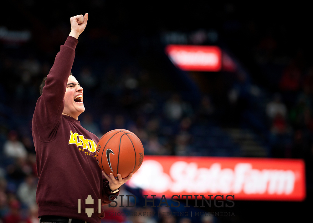 A fan from Loyola University Chicago prepares to participate in a promotional event during the Ramblers' game against Bradley University during the semifinals of the Missouri Valley Conference men's basketball tournament at Scottrade Center in St. Louis Saturday, March 3, 2018. Photo © copyright 2018 Sid Hastings.