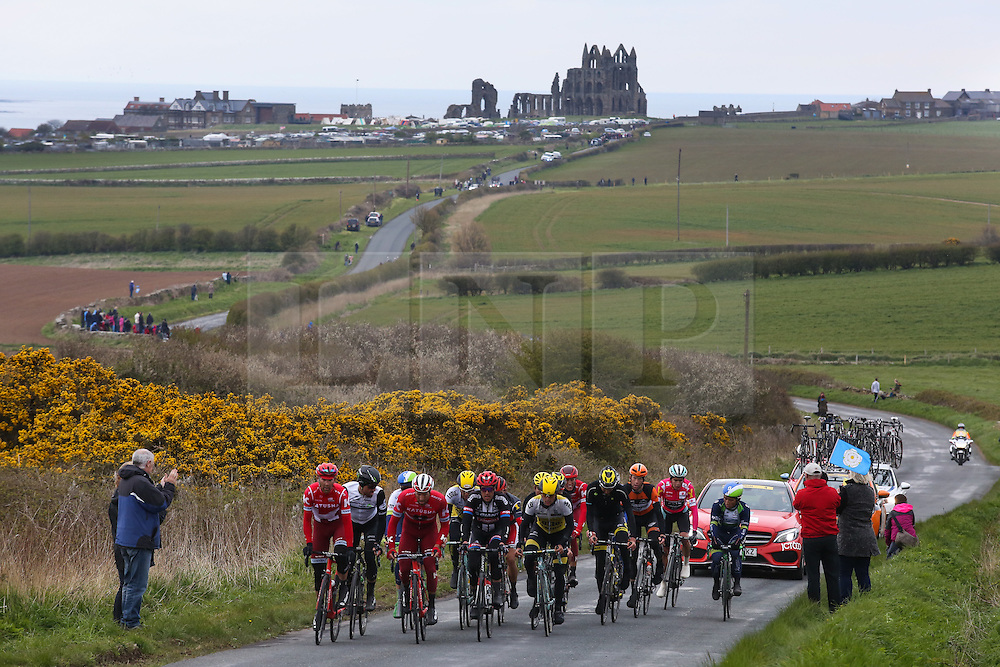 © Licensed to London News Pictures. 01/05/2016. Whitby, UK. The peloton, with the famous abbey behind them, makes it's way out of Whitby during the third and final stage of the 2016 Tour De Yorkshire. The three-day road cycling race held annually across Yorkshire is in it's second year. Photo credit : Ian Hinchliffe/LNP