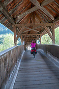 Wooden pedestrian bridge over the Inn River near Prutz, Tyrol, Austria