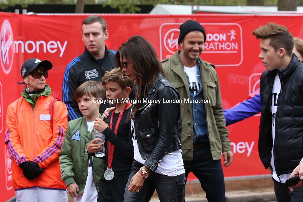 Mini London marathon 2015, The Borough Challenge Boys Under 13 race.  Victoria Beckham puts her arm around her son Romeo Beckham (12) after the finish of the race on The Mall. The Virgin Money Giving Mini Marathon, Sunday 26th April 2015.<br />