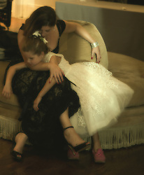 mother and daughter seated on a couch at a wedding reception