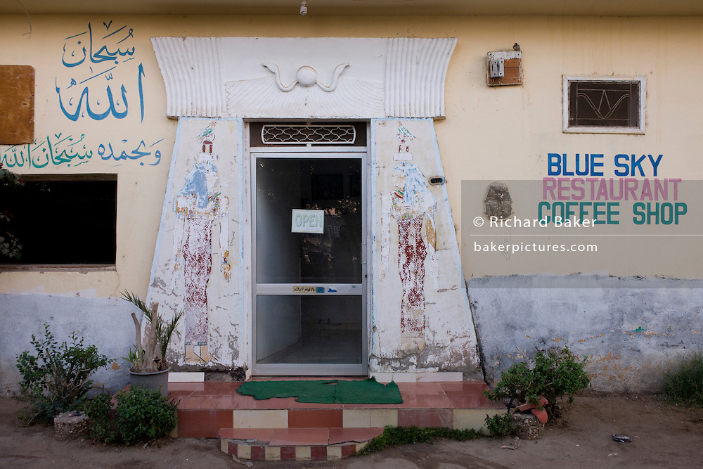 The Blue Sky Cafe, a business dependent on tourism using the ancient Egyptian pylon design for its entrance, in the village of Bairat on the West Bank of Luxor, Nile Valley, Egypt.