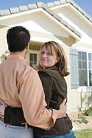 Couple admiring new house