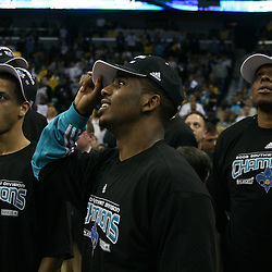 15 April 2008: Chris Paul of the New Orleans Hornets (center) celebrates with teammates Jannero Pargo (left) and Bonzi Wells (left) after the team clinched the franchise's first Southwest Division Championship with a 114-92 victory over the Los Angeles Clippers at the New Orleans Arena in New Orleans, Louisiana.