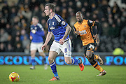 Joe Ralls (Cardiff City) runs away from Sone Aluko (Hull City) with the ball during the Sky Bet Championship match between Hull City and Cardiff City at the KC Stadium, Kingston upon Hull, England on 13 January 2016. Photo by Mark P Doherty.