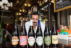 General Manager Jon Huddart with an array of bottled beers from the United States. Available at The Craft Beer Co's Clerkenwell pub at 82 Leather Lane, London, is Evil Twins' Molotov Heavy, an IPA beer that at 17.2 ABV will cost you £19.50 for a pint - although it is usually served in half pints or thirds. The Craft Beer Co specialises in micro-brewed cask ales, small batch craft beers and offers over 400 different bottled beers from around the world, including one, American brewer Alesmith's 'Reforged XX ', which is aged in bourbon barrels, at £105 for a 750ml bottle. London, August 24 2018.