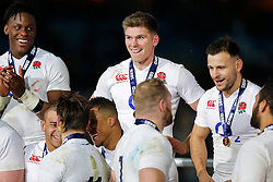 England Inside Centre Owen Farrell celebrates after winning the match to complete their Six Nations title with the Grand Slam - Mandatory byline: Rogan Thomson/JMP - 19/03/2016 - RUGBY UNION - Stade de France - Paris, France - France v England - RBS 6 Nations 2016.
