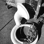 2014 JUNE 20 - A sousaphone lies on a sidewalk in Georgetown, Seattle, WA during HonkFest West. By Richard Walker