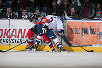 KELOWNA, CANADA - NOVEMBER 23:   Henrik Nyberg #21 of the Kelowna Rockets and Colby Williams #5 of the  Regina Pats fight for the puck against the boards at the Kelowna Rockets on November 23, 2012 at Prospera Place in Kelowna, British Columbia, Canada (Photo by Marissa Baecker/Shoot the Breeze) *** Local Caption ***Henrik Nyberg;Colby Williams;