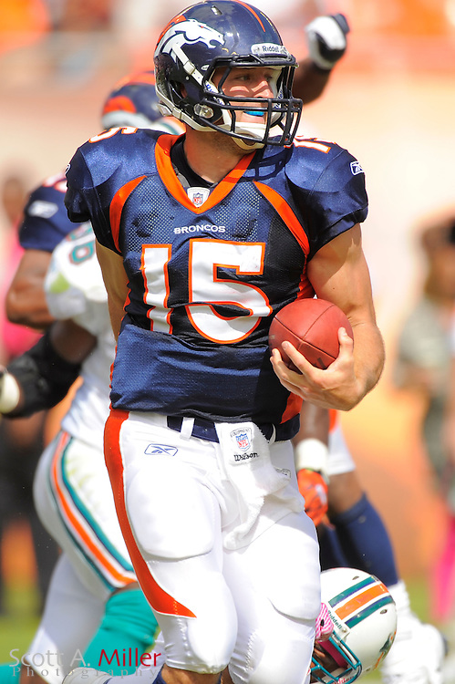 Denver Broncos quarterback Tim Tebow (15) in action during the Broncos 18-15 overtime win against the Miami Dolphins at Sun Life Stadium on Oct. 22, 2011 in Miami Gardens, Fla.  ...©2011 Scott A. Miller