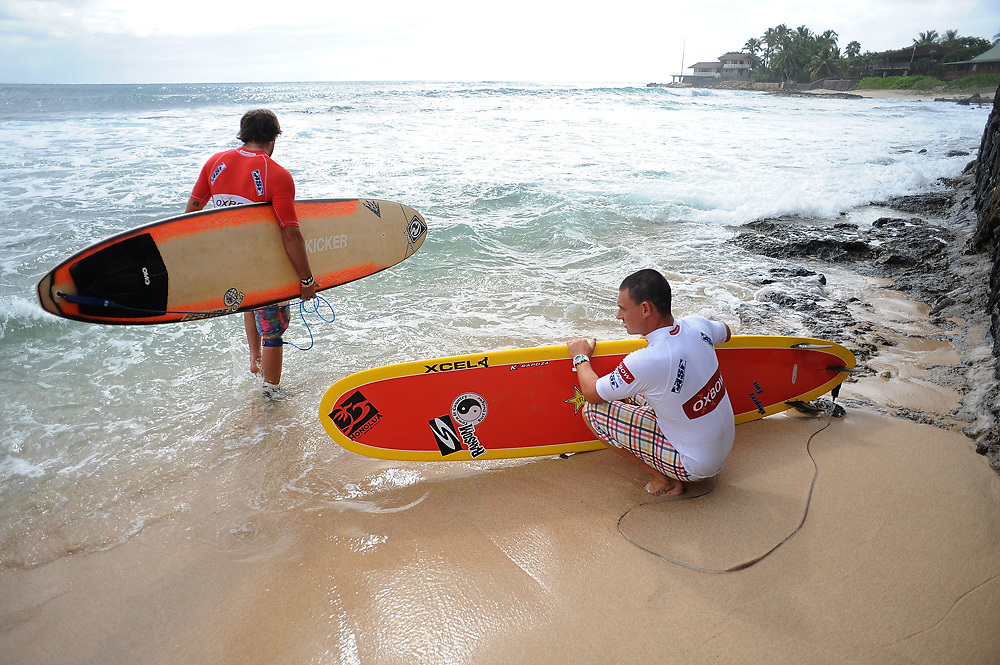 November 3rd  2010: Dane Pioli and Taylor Jensen make their way out to the line up during round 1 of the ASP World Longboard Championship at Makaha Oahu-Hawaii. Photo by Matt Roberts/mattrIMAGES.com.au