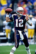 FOXBORO, MA - OCTOBER 13: Tom Brady #12 of the New England Patriots looks to pass the football against the Green Bay Packers at Gillette Stadium on October 13, 2002 in Foxboro, Massachusetts. The Packers defeated the Patriots 28-10. (Photo by Joe Robbins) *** Local Caption *** Tom Brady