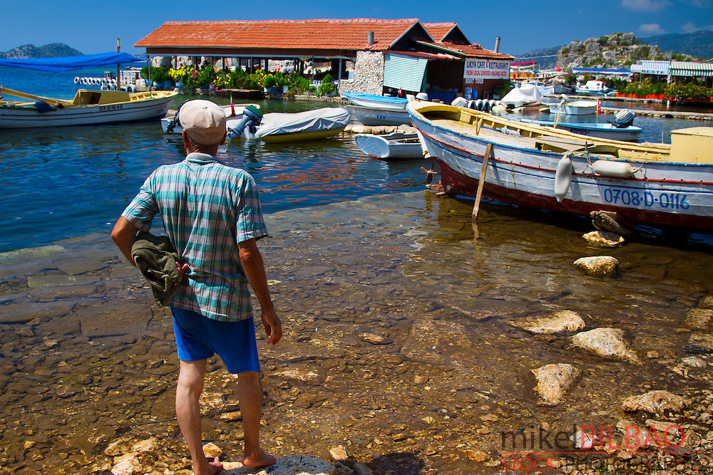 Shoreline and man..Kaleköy. Antalya province. Mediterranean coast. Turkey.