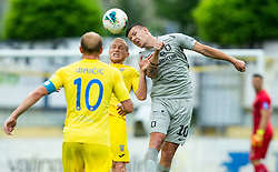 Zeni Husmani of Domzale vs Roman Bezjak of Olimpija during football match between NK Domzale and NK Olimpija in 29th Round of Prva liga Telekom Slovenije 2019/20, on June 21, 2020 in Sports park, Domzale, Slovenia. Photo by Vid Ponikvar / Sportida