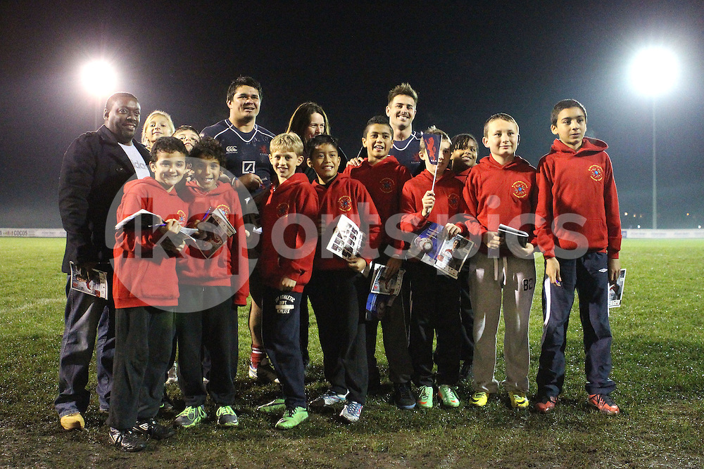 PJ Gidlow and Matt Heeks pose with local schoolchildren after the Green King IPA Championship match between London Scottish &amp; Jersey at Richmond, Greater London on Friday 14th November 2014<br /> <br /> Photo: Ken Sparks | UK Sports Pics Ltd<br /> London Scottish v Jersey, Green King IPA Championship,14th November 2014<br /> <br /> &copy; UK Sports Pics Ltd. FA Accredited. Football League Licence No:  FL14/15/P5700.Football Conference Licence No: PCONF 051/14 Tel +44(0)7968 045353. email ken@uksportspics.co.uk, 7 Leslie Park Road, East Croydon, Surrey CR0 6TN. Credit UK Sports Pics Ltd