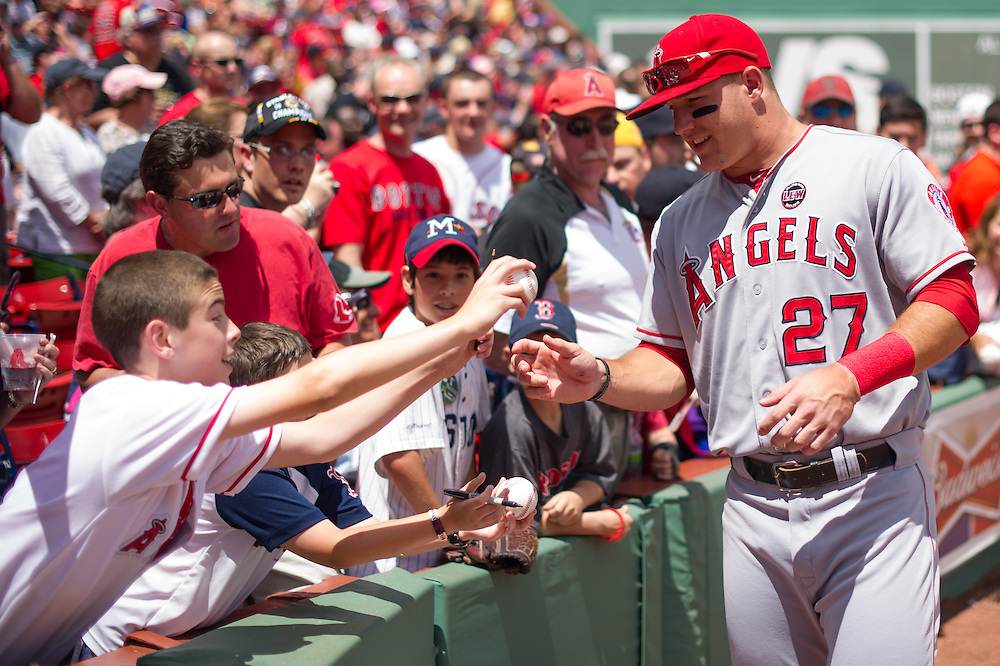 BOSTON, MA - JUNE 09: Mike Trout #27 of the Los Angeles Angels signs autographs for fans before the game against the Boston Red Sox at Fenway Park in Boston, Massachusetts on June 9, 2013. (Photo by Rob Tringali) *** Local Caption *** Mike Trout