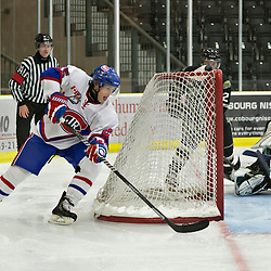 COBOURG, ON - Oct 21 : Ontario Junior Hockey League Game Action between Cobourg Cougars Hockey Club & Toronto Junior Canadians Hockey Club, Aaron Spivak #25 of the Toronto Canadiens Hockey Club goes for the goal<br /> (Photo by Dave Powers / OJHL Images)