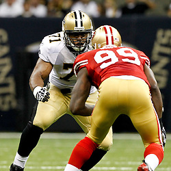 August 12, 2011; New Orleans, LA, USA; New Orleans Saints offensive tackle Charles Brown (71) works against San Francisco 49ers linebacker Aldon Smith (99) during the second half of a preseason game at the Louisiana Superdome. The New Orleans Saints defeated the San Francisco 49ers Mandatory Credit: Derick E. Hingle