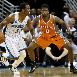 April 8, 2011; New Orleans, LA, USA; New Orleans Hornets point guard Chris Paul (3) is guarded by Phoenix Suns point guard Aaron Brooks (0) during the third quarter at the New Orleans Arena. The Hornets defeated the Suns 109-97.   Mandatory Credit: Derick E. Hingle