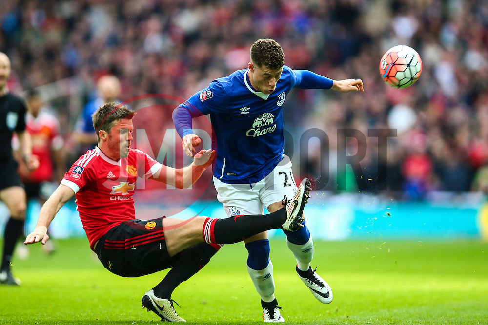 Michael Carrick of Manchester United clears the ball under pressure from Ross Barkley of Everton - Mandatory byline: Jason Brown/JMP - 07966386802 - 23/04/2016 - FOOTBALL - Wembley Stadium - London, England - Everton v Manchester United - The Emirates FA Cup