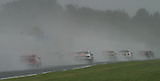 8th November, 2003, V8 Supercars, @ Pukekohe, Auckland, New Zealand. Day 02<br />The rain comes down on race one as the V8 supercars head down the back straight.<br />Greg Murphy went on to win race one.<br />Pic : Chris Skelton/ Photosport
