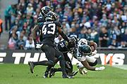 Philadelphia Eagles Josh Adams RB (33) is tackled by Jacksonville Jaguars Tashaun Gipson S (39) during the International Series match between Jacksonville Jaguars and Philadelphia Eagles at Wembley Stadium, London, England on 28 October 2018.