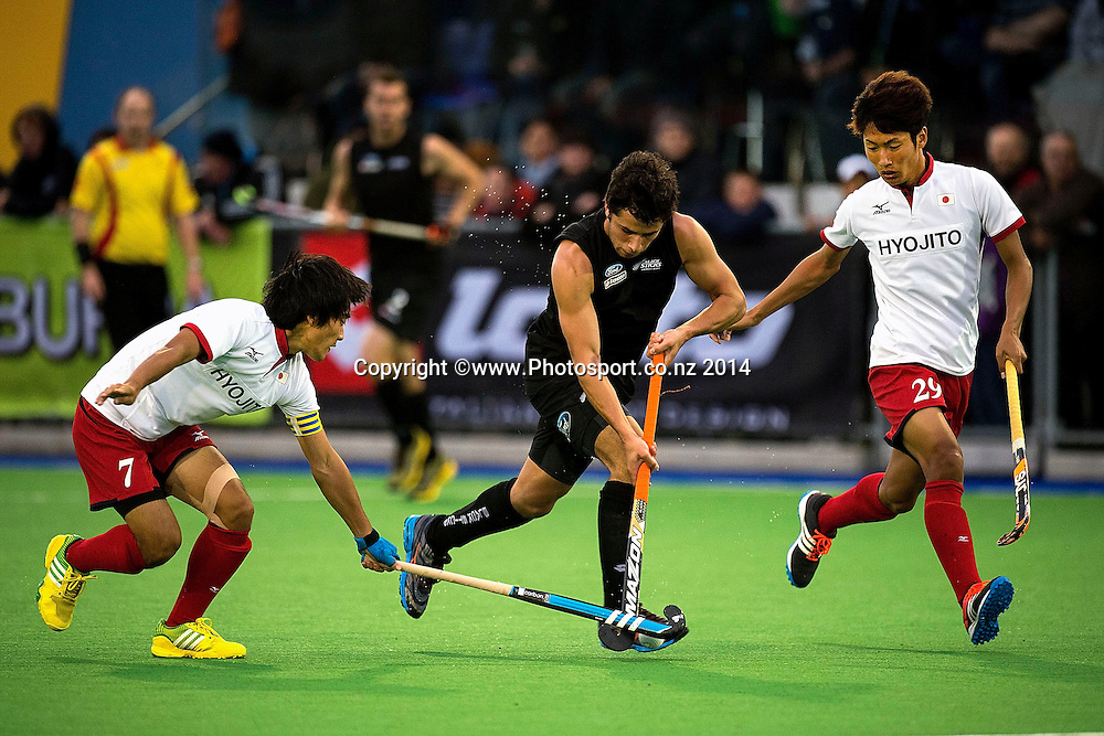 George Muir (C of New Zealand dribbles the ball with Tomonori Ono (L) and Koshi Yamabe of Japan in defense during the Black Sticks Men v Japan international hockey match at the Coastlands Kapiti Sports Turf in Paraparaumu on Friday the 21st of November 2014. Photo by Marty Melville/www.Photosport.co.nz