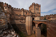 Segovia, The Coca castle, not far from Segovia, constructed in the 15th century has been considered to be one of the best examples of Spanish Mudejar brickwork which incorporates Moorish Muslim design and construction with Gothic architecture